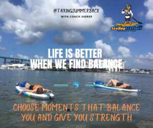 finding balance paddle boarding - image